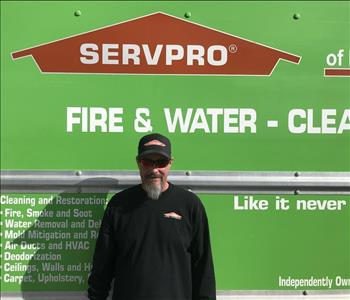 Kevin posing in front of SERVPRO Logo Box Truck