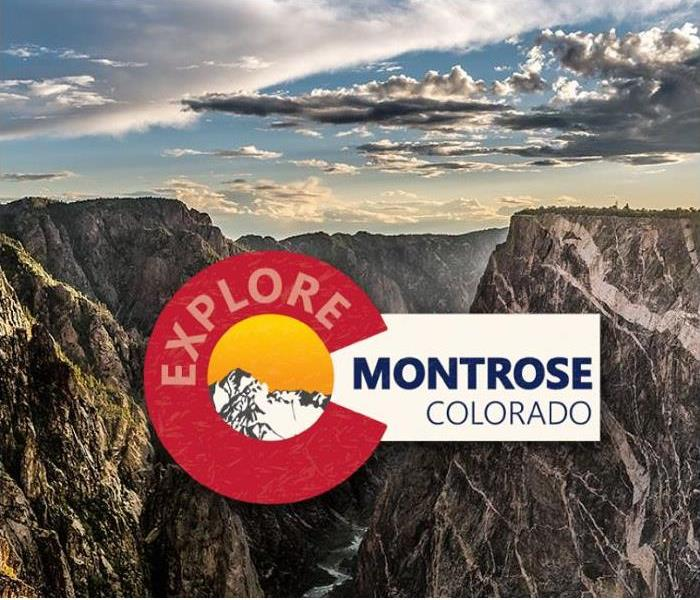 Montrose logo and mountains in background