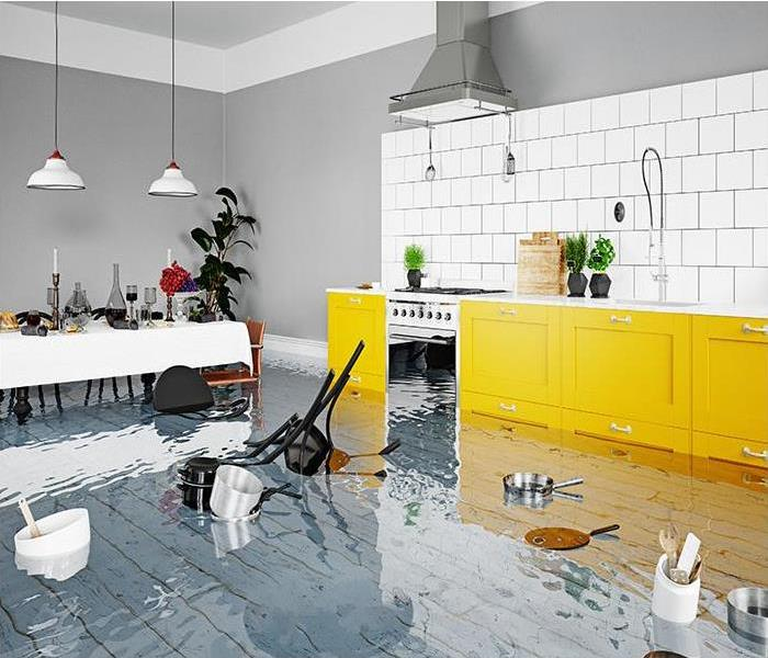 flooded kitchen with debris floating
